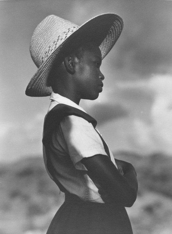 Girl with Straw Hat by Consuelo Kanaga, 1940