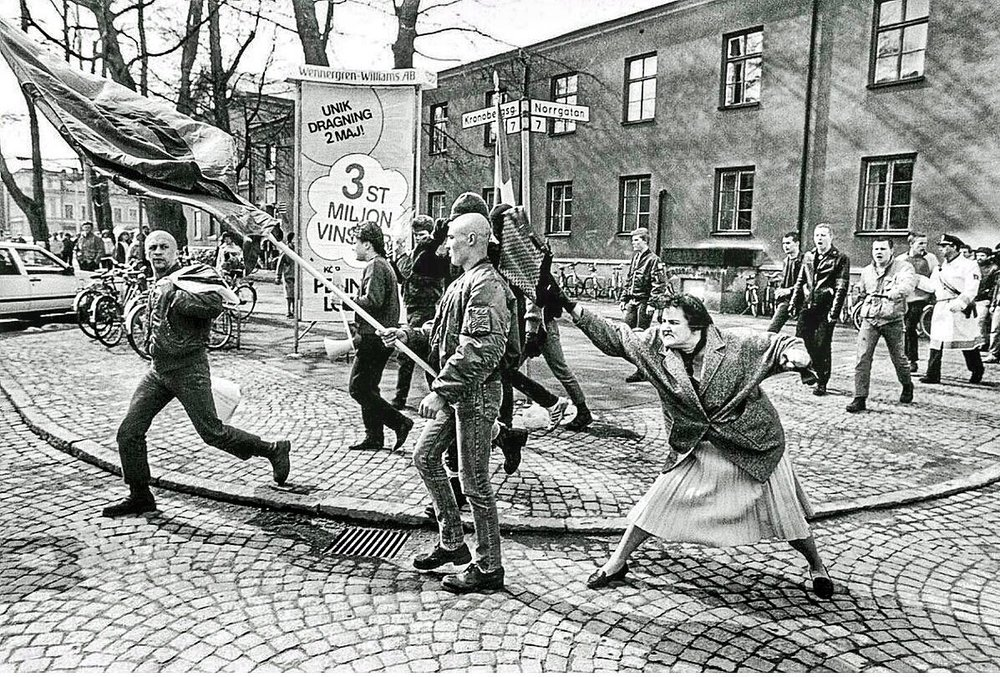 A Woman (Danuta Danielsson) Hitting a Neo-Nazi With Her Handbag by Hans Runesson, 1985