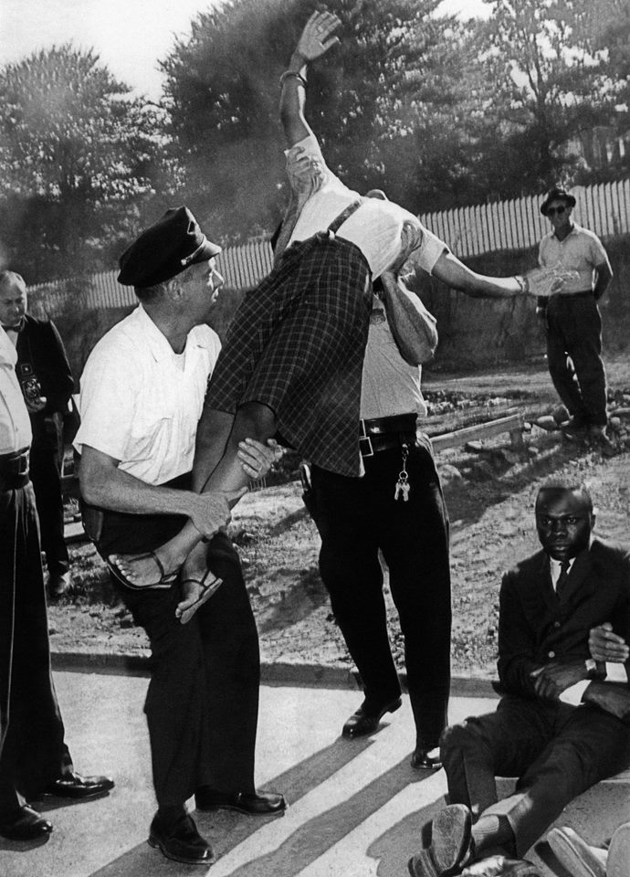 Policemen grabbed hold of 18-year old Elizabeth Victoria Spencer, a city youth council delegate, during a segregation protest on August 7, 1963
