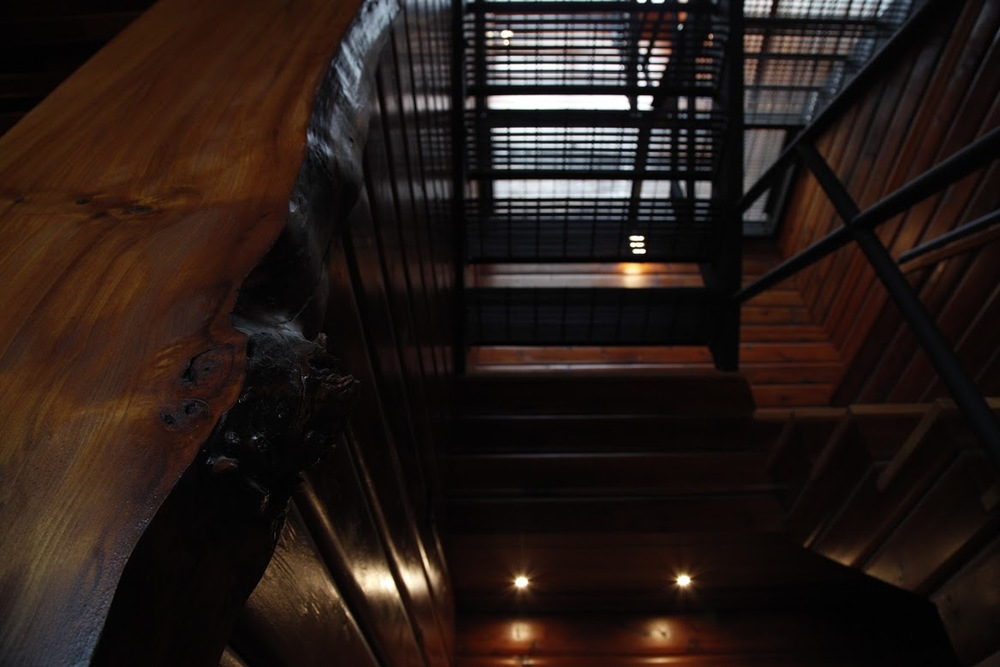 Madrona Drive Staircase successfully combining elements of the old/rustic and new