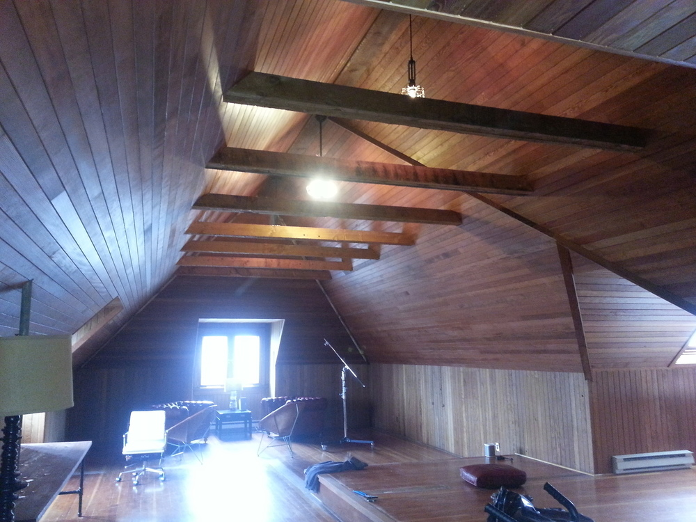 Wood paneling applied to walls, and ceilings give this project by us a warm, beautiful rustic feel