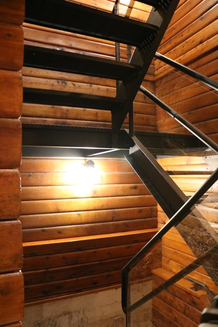 Glass, metal and wood stairwell custom made by us