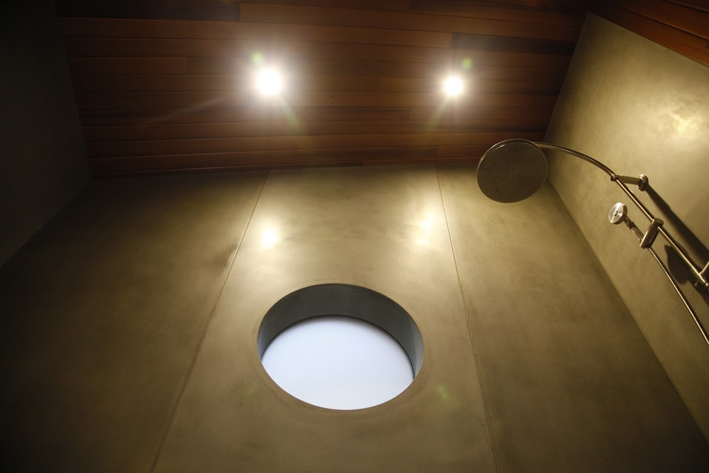 Precast customer polished concrete shower wall makes this a stunner - Madrona Dr project