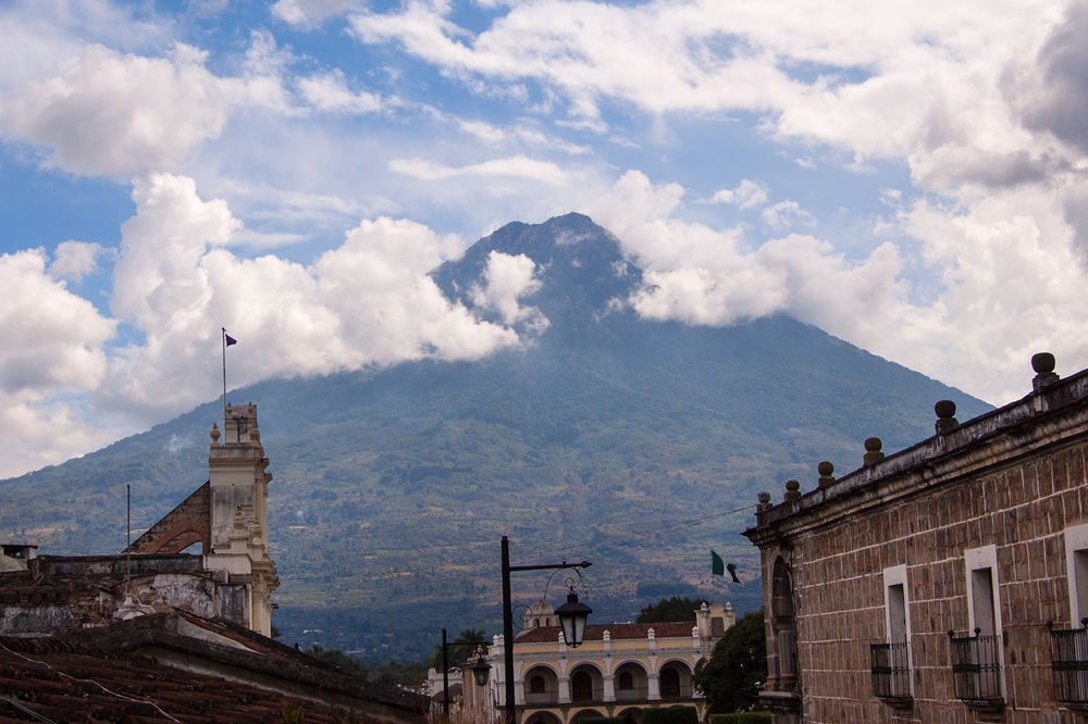 Volcán de Agua, Antigua. Hacienda Carmona rests at the base of the volcano to the left. Finca Bella Vista sits to the right (behind and to the right of the streetlamp).
