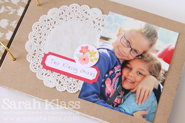 One of several kraft pages, prettied up with a doily and some die cuts