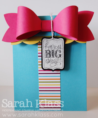 Stamps: Chalk Talk Paper: Tempting Turquoise, Melon Mambo, Daffodil Delight, Old Olive, Basic Black, Sweet Taffy Designer Series Paper Ink: Versamark Accessories: Gift Bow Bigz Die, Chalk Talk Framelits, Large Scallop Edgelit, White Baker's Twine, White Embossing Powder