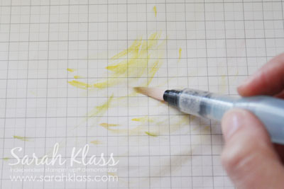 Clean the excess ink from the aquapainter by brushing it on scrap paper