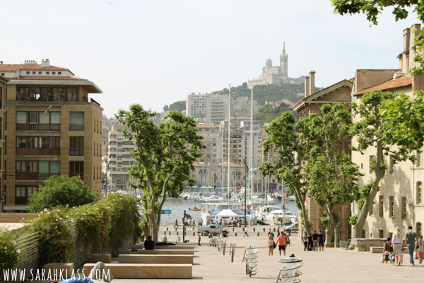 Marseilles Old Port area with the Basilique Notre Dame de la Garde on the hill in the background