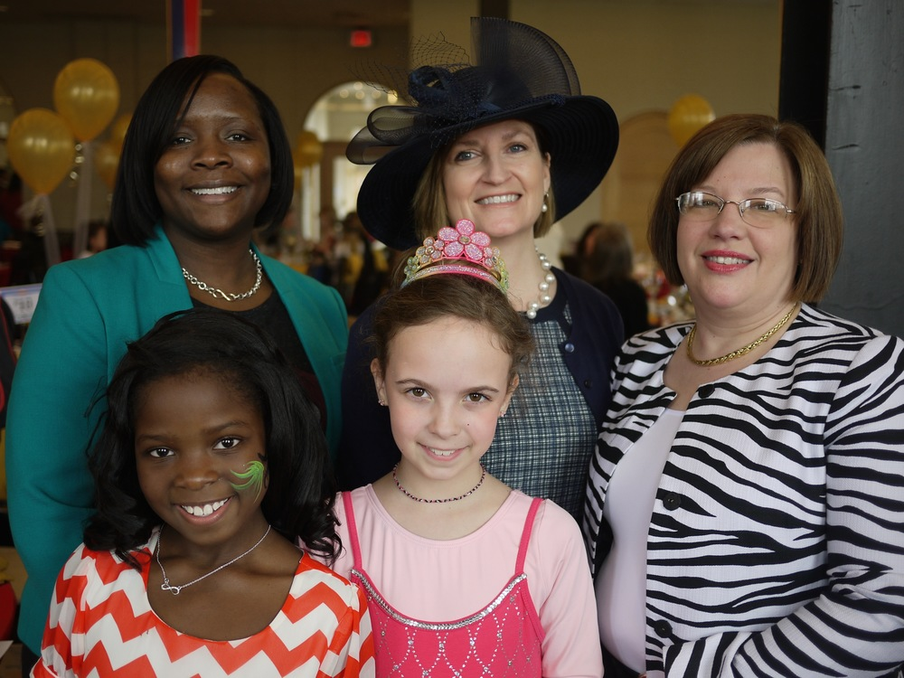 FPF President and Executive Director Lesley Hoffarth (center), with 2014 Wonderland Tea Party Co-Chairs Shonté Moore and Makenzie Roberts ( (left) and Gen Frank and Gabby Schmiedeke.