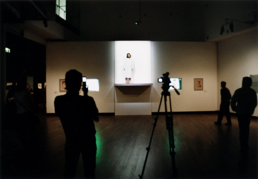 Yingmei Duan performing in the Van Gogh Museum in Amsterdam, the Netherlands in 2005.  Photograph by Constanze Schmidt