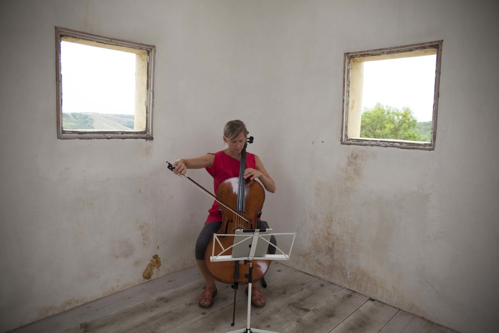 "Odyssey Works' cellist Leanne Zacharias  performing ""When I Left the House it Was Still Dark"" in  Saskatchewan, Canada, in 2013. Photograph by Ayden L. M. Grout"