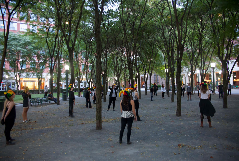 """Nearly one hundred complete strangers and members of the public convening at Metrotech Plaza for the climax of the penultimate day of """"When I Left the House it Was Still Dark"""" in New York City, in 2013.Photograph by Ayden L. M. Grout"""