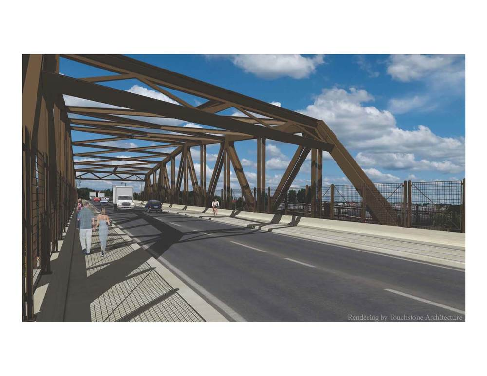 Rendering of the interior of the proposed truss.  The new space-frame through-truss references the 5 Warren through-trusses that it will replace while embracing new ideas and approaches to engineering.  Note the 14 foot wide trail on the south, one traffic lane in each direction, and a 10 foot wide sidewalk on the north.  The railing, located within the truss on the exterior edges of the trail and sidewalk, is comprised of mesh panels supported by steel posts all atop a concrete parapet.
