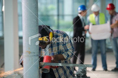 stock-photo-25047126-construction-team-with-welder-in-the-front.jpg