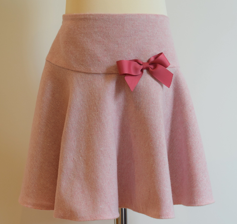 Pink wool skirt   Description: pretty circular style giving it a lovely fullness, matching grosgrain ribbon bow, concealed zip at side, adjustable elastic waist  Sizes: available in 4y (SOLD OUT), 5y and 6y  From £32
