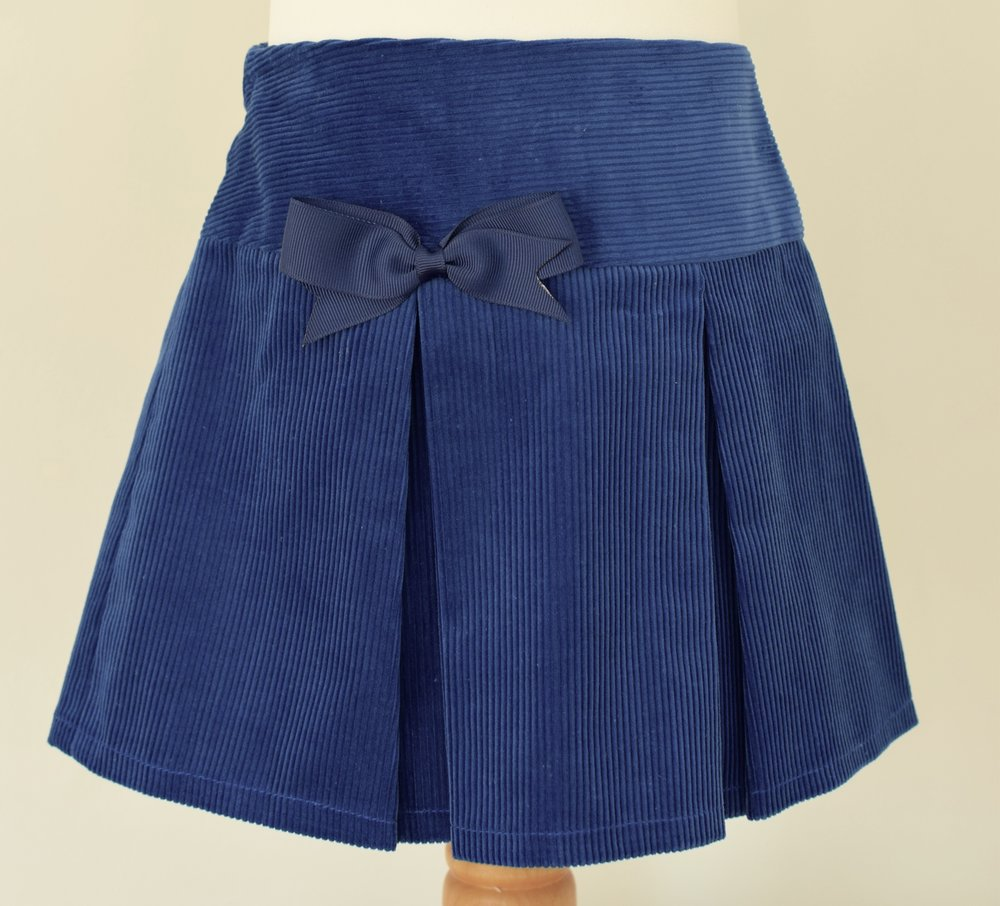 Royal blue corduroy skirt   Description: pretty pleats front and back, matching grosgrain ribbon bow, concealed zip and button at back, elastic waist  Sizes: available in 4y, 5y and 6y  £22