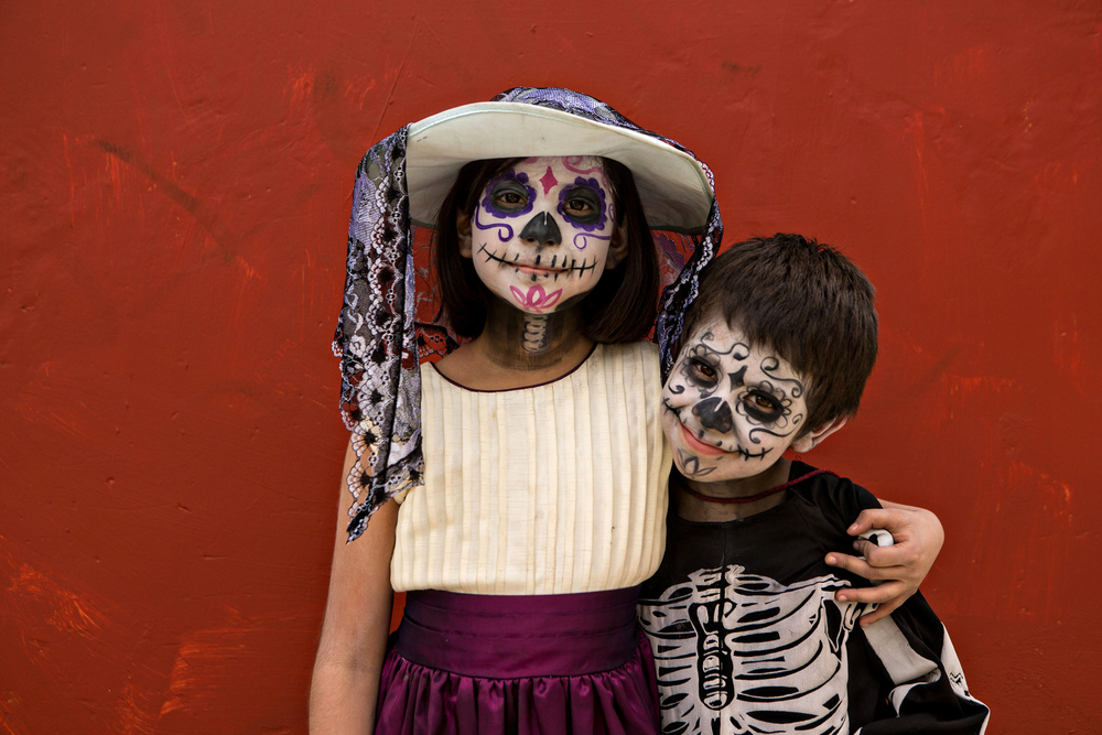 Young Mexican children dressed in costumes smile during the Day of the Dead Festival known in spanish as Dia de Muertos on November 1, 2013 in Oaxaca, Mexico.