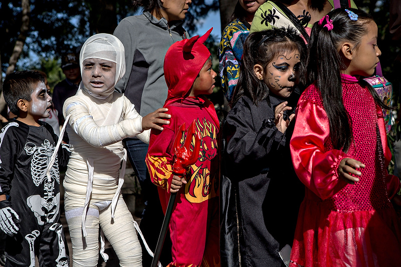 Children dressed in costumes parade at the start of the Day of the Dead festival known in spanish as Día de Muertos October 30, 2013 in Oaxaca, Mexico.