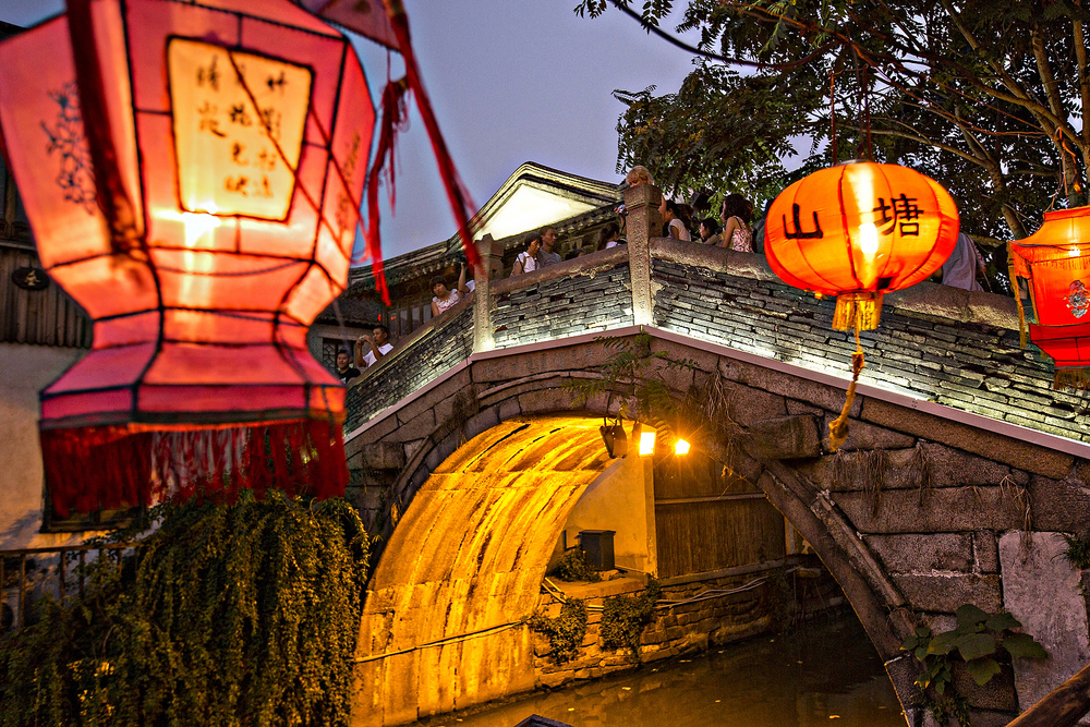Tong Gui Bridge at night along Shantang canal in Suzhou, China.