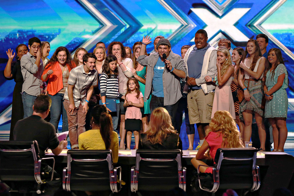 Singer Carlos Guevara is surrounded by his friends as he is chosen for the X-Factor in Charleston, SC