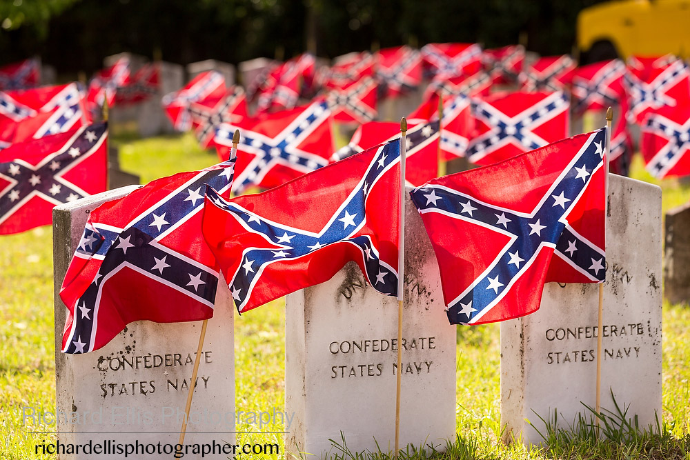 Confederate flags decorate the tombstones of Civil War soldiers during a ceremony marking Confederate Memorial Day at Magnolia Cemetery April 10, 2014 in Charleston, SC. Confederate Memorial Day honors the approximately 258,000 Confederate soldiers that died in the American Civil War.