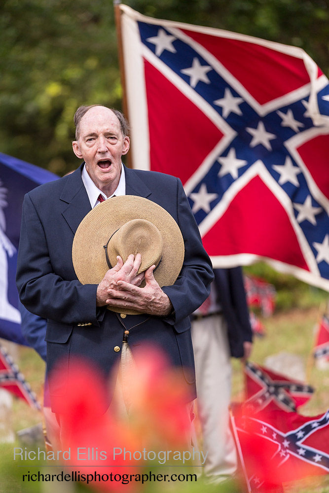 "A descendant of Civil War soldiers sings ""Dixie"" during a ceremony marking Confederate Memorial Day at Magnolia Cemetery April 10, 2014 in Charleston, SC. Confederate Memorial Day honors the approximately 258,000 Confederate soldiers that died in the American Civil War."