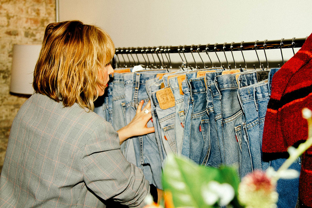 Hannah sorting throught jeans that will always be 30 dollars and only 30 dollars