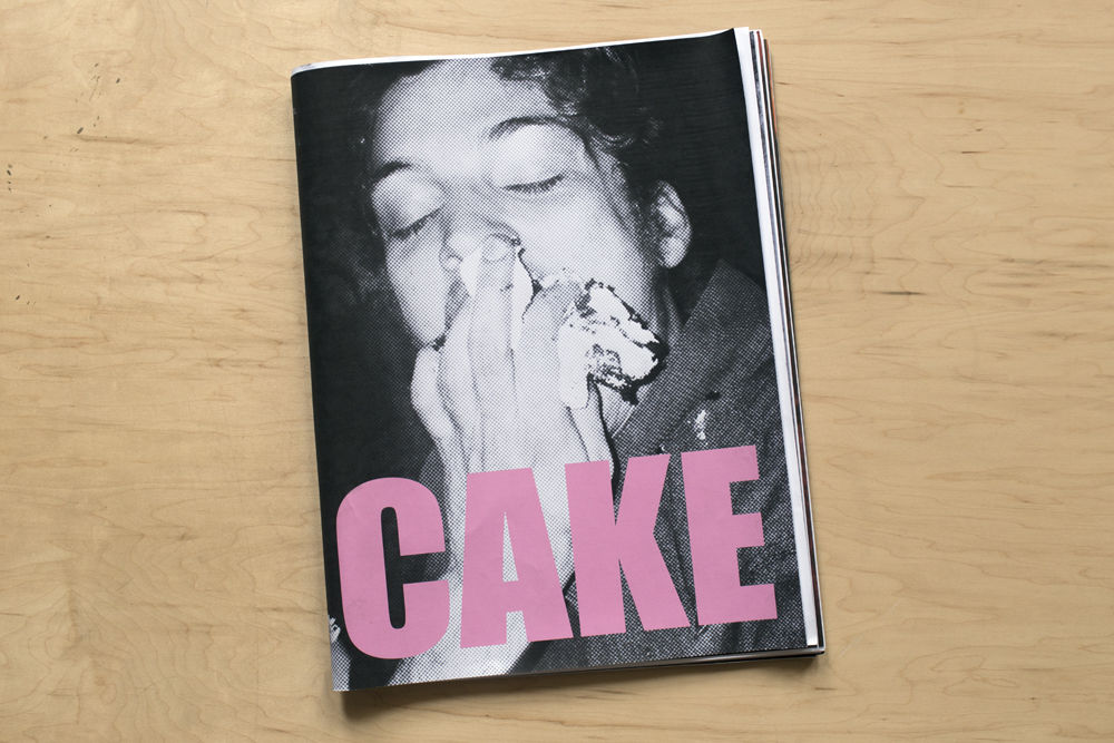 "The cover of Caitlin's newly released zine, ""Cake,""  which features photos from The Districts / Sun Club fall US tour."