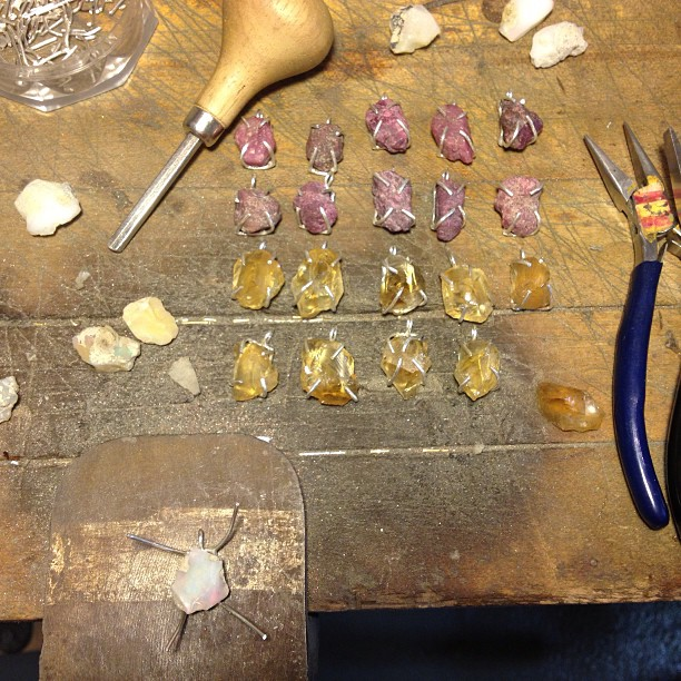 Setting rough rubies, citrines and opals today headed to @uncommongoods for their website and catalogue!!  #jewelry #handmade #studioshot (at We Are Here Studio)