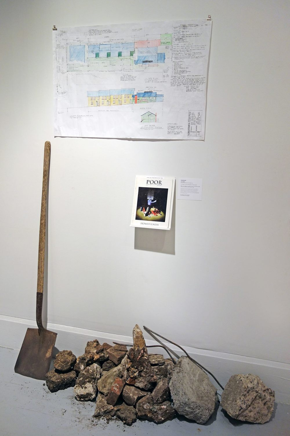 Installation about Poor Magazine's Homefulness project including shovel and broken foundation from their land, map of the upcoming homefulness housing project and original 1996 first issue of Poor Mag's Homefulness idea and vision.   — with  Lisa Tiny Gray-Garcia  and  POOR Magazine .