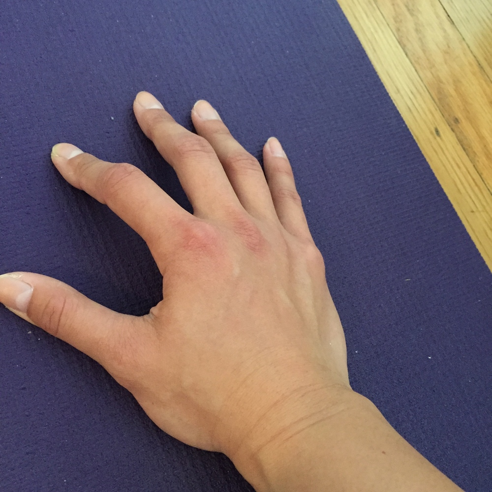 Wrong option #2: The inner palms and fingers are lifted, which create instability in the hands and upper body while in downward facing dog. This also creates a lot of pressure in the wrists.