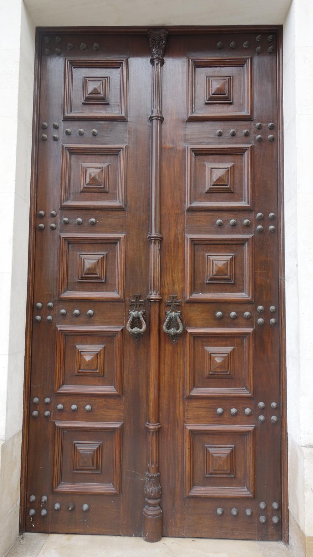Door in Tomar, notice the Templar Cross on the knockers.