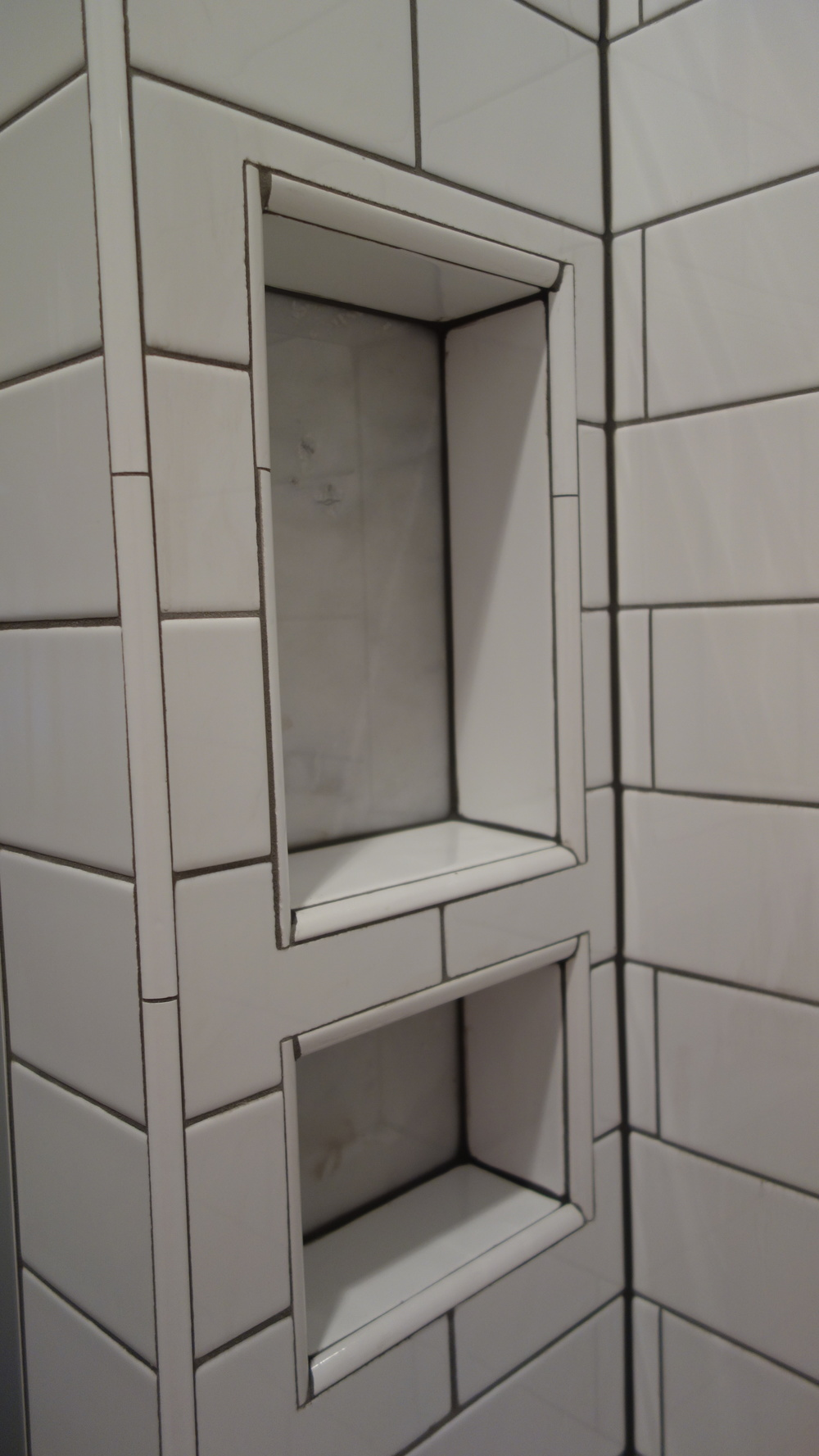 Hidden shower niche to house product