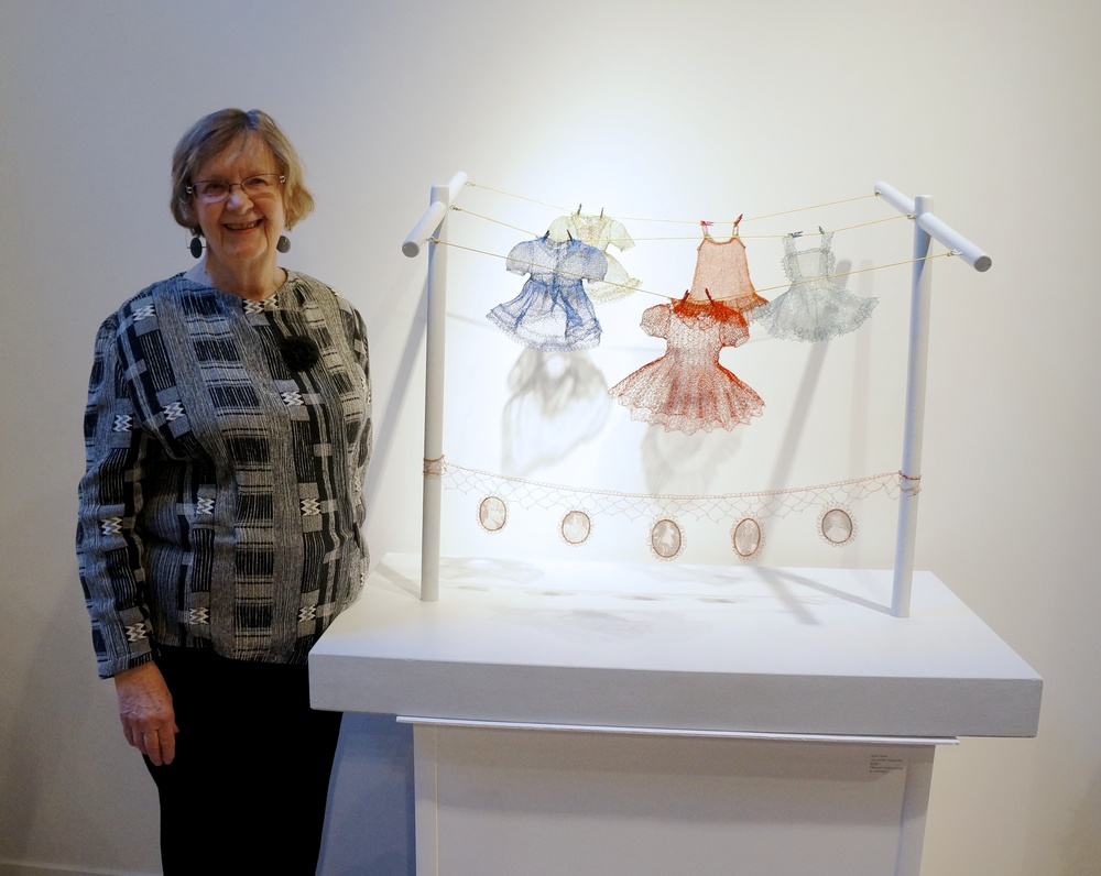 Karen Searle and her piece,  How Mother Dressed Me , hand crocheted and knit metal wire dresses.