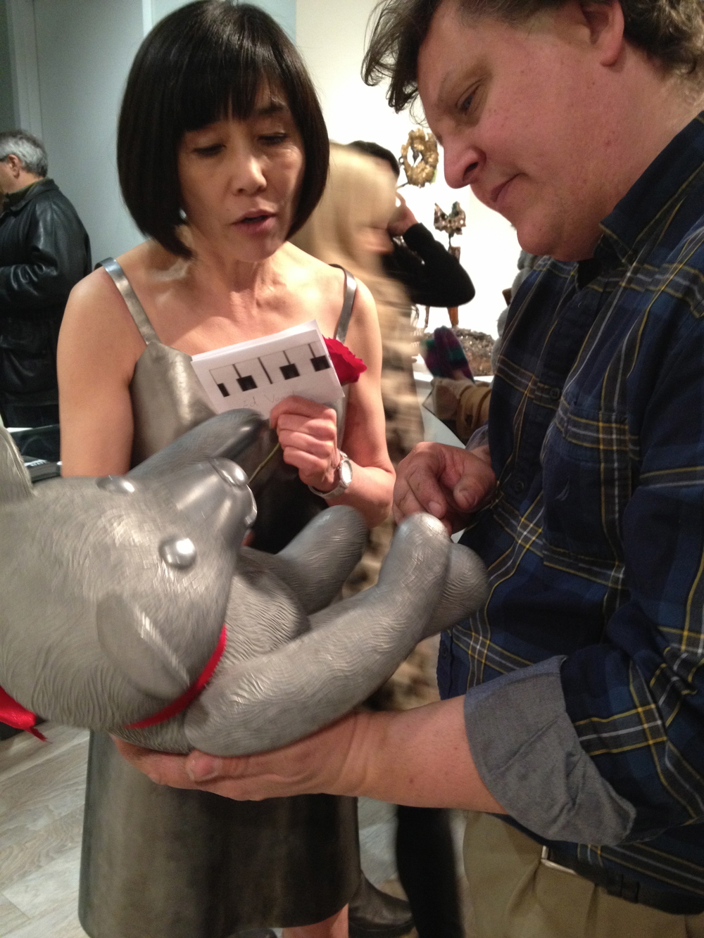 Mayumi Amada and Kyle Fokken discuss the construction of Mayumi's bear.