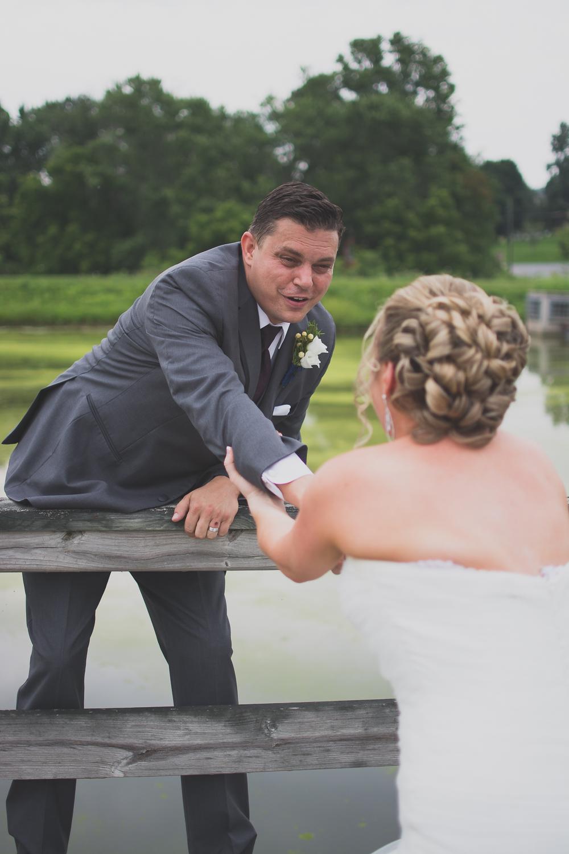 Catoctin Hall at Musket Ridge Wedding bride and groom on bridge Photo