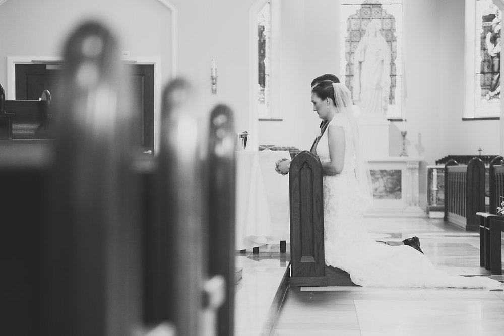 Whitehall Estate and Winery Wedding bride and groom at catholic church alter Photo