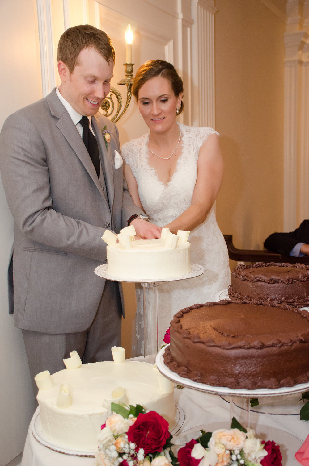 Whitehall Estate and Winery Wedding bride and groom cutting cake Photo