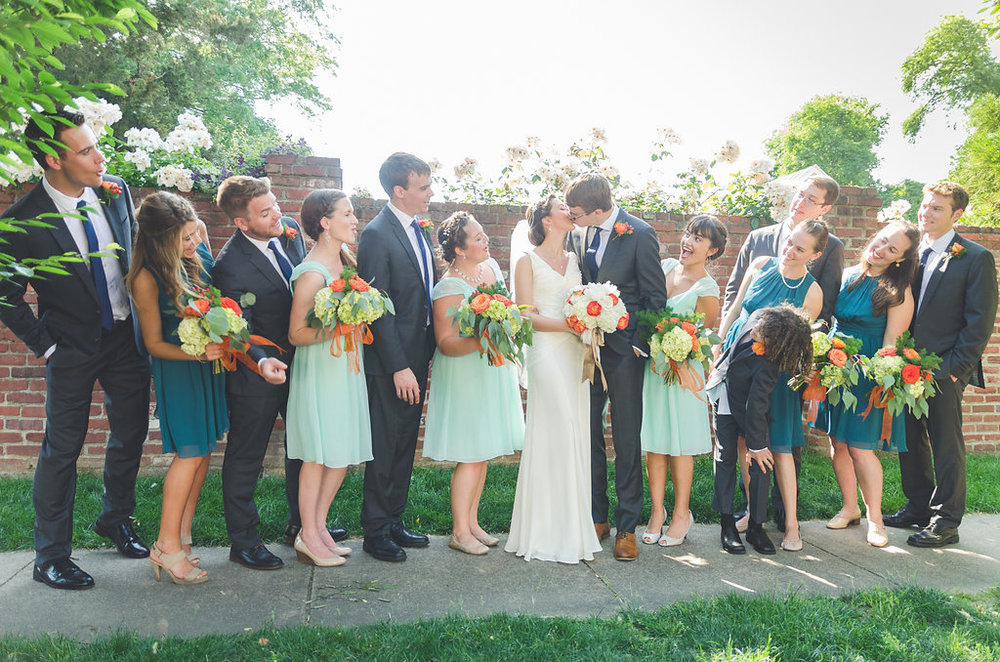 chic girl flowers bridal party happy first kiss bride and groom old town alexandria wedding