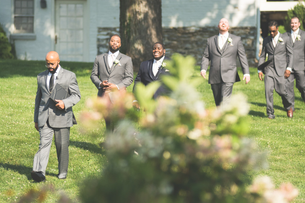 groom and groomsmen walking to alter glen ellen farm