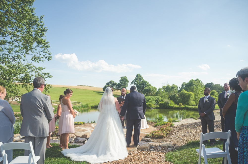 bride and groom at alter with pond glen ellen farm