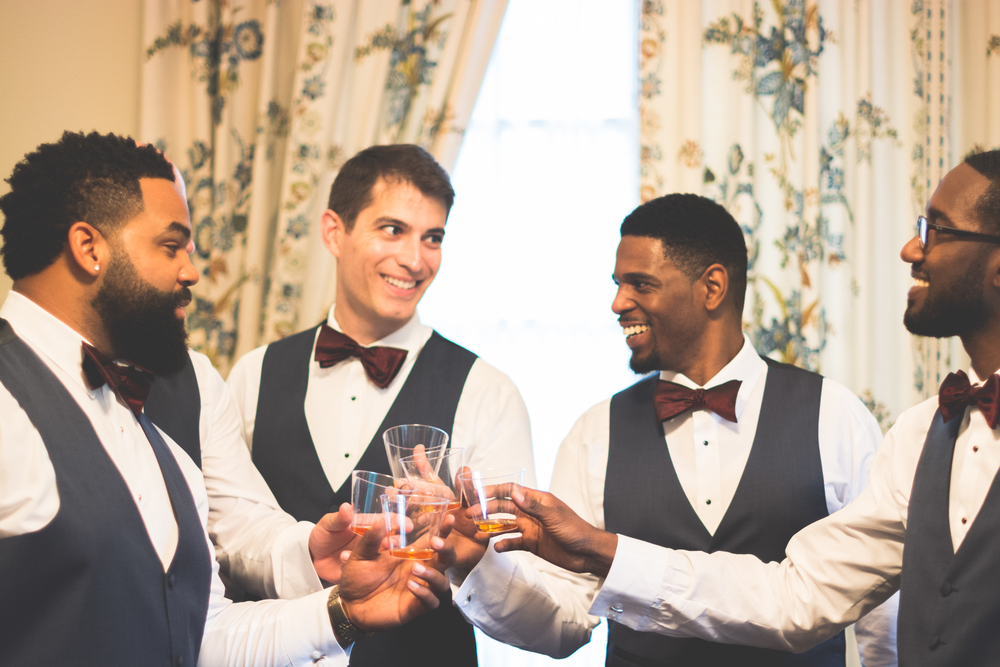 strong mansion wedding groom toasting photo