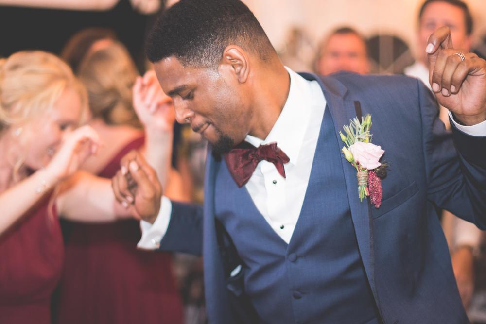 strong manor groom dancing photo