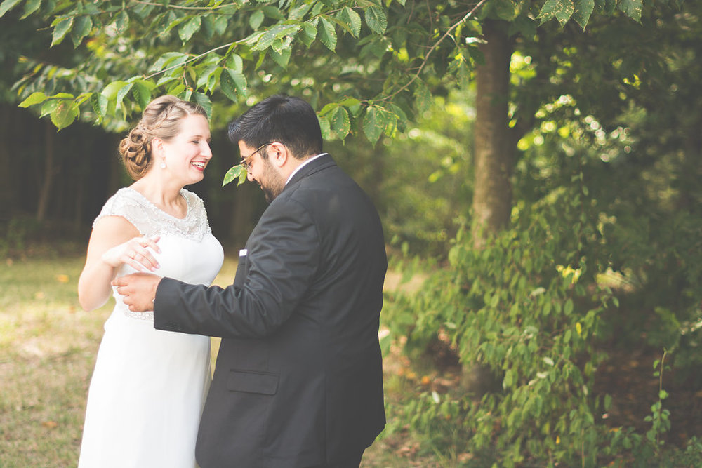bride and groom first look photo