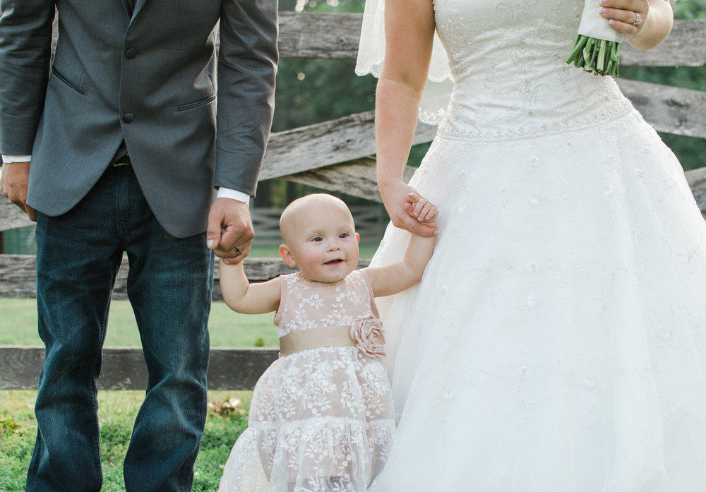 bride and groom with daughter photo