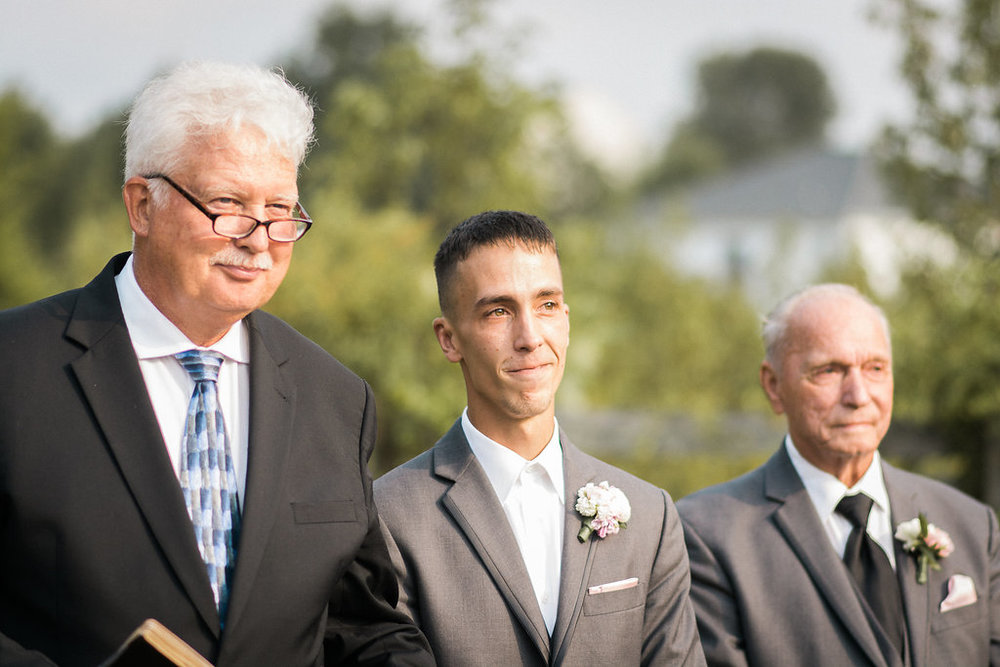 groom seeing bride for first time at wedding ceremony photo