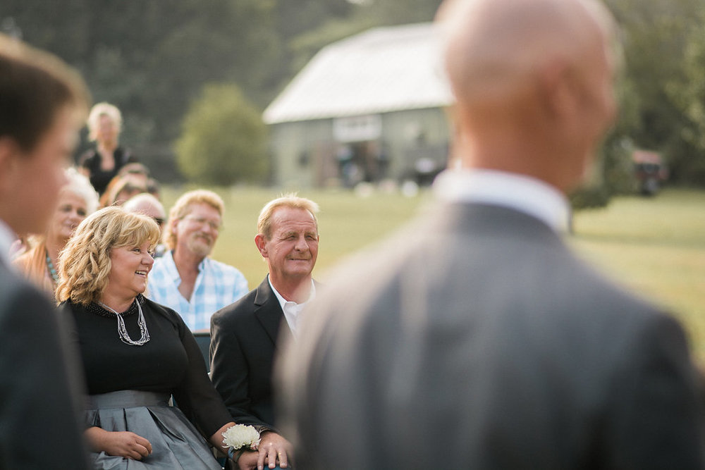 candid father wedding ceremony photo