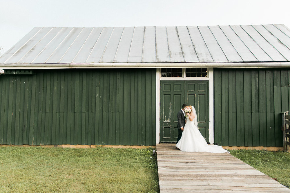 country bride and groom at glasgow farm photo