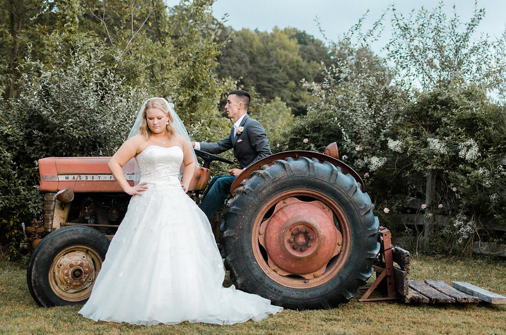 country bride and groom on tractor photo