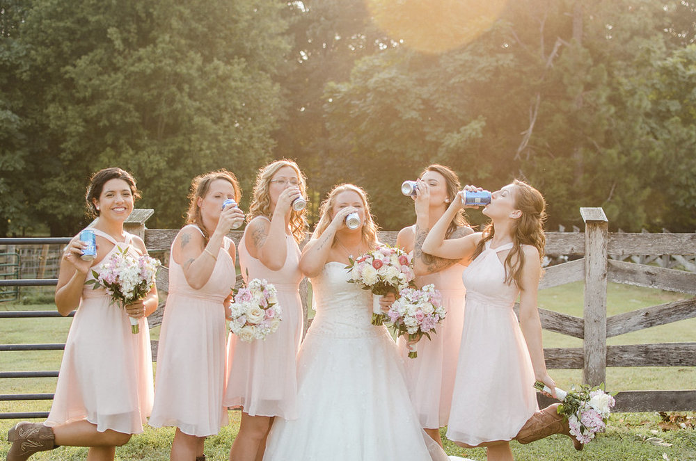 country bride and bridesmaids drinking budlight photo